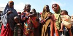 Internally displaced Somali women wait to receive supplies at an IDP camp in Hodan district, south of Mogadishu